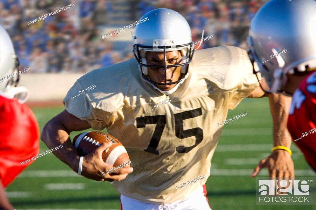 Stock Photo: Running back running with football.