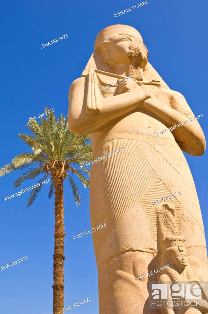 Stock Photo: Statue of the great pharaoh Rameses II with small statue of his daughter Bent'anta between his legs in the forecourt behind the first Pylon of the great Temple.