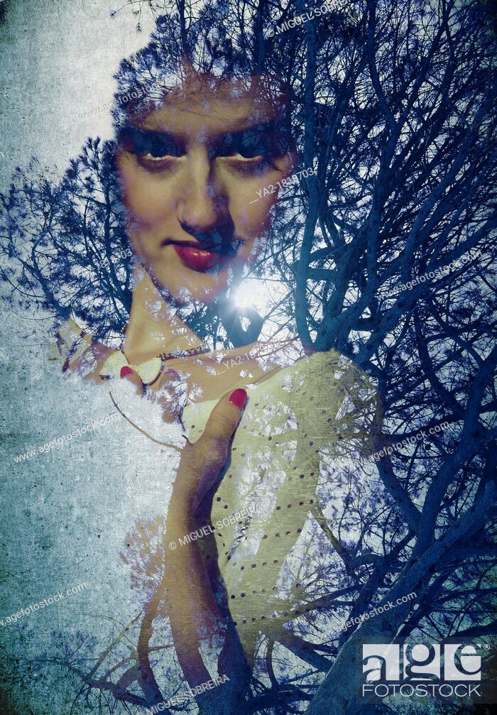Stock Photo: Woman's Face in the Trees.