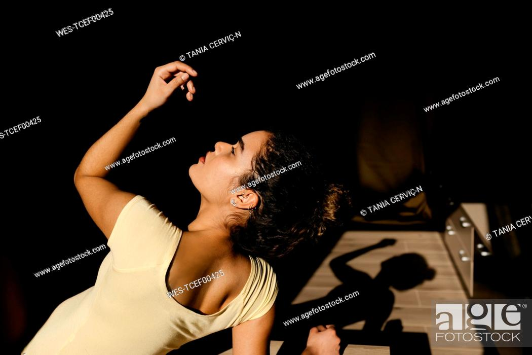 Stock Photo: Portrait of attractive young woman in sunlight.