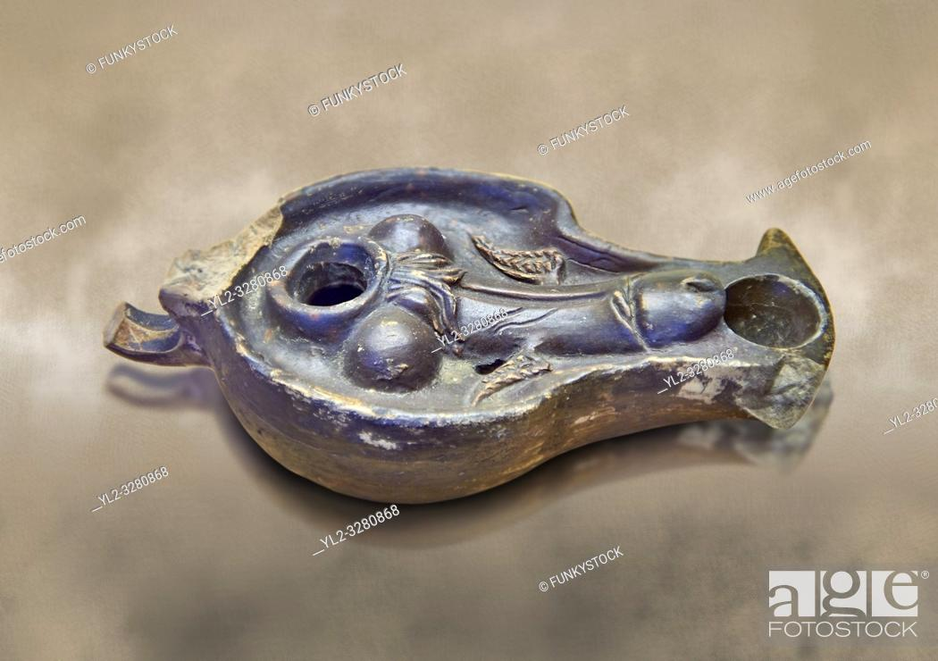 Stock Photo: Roman oil lamp black-painted with winged phallus, inv no 27867, Secret Museum or Secret Cabinet, Naples National Archaeological Museum , brown background.
