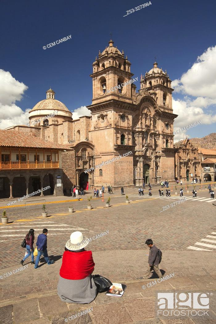 Stock Photo: View to the La Compania De Jesus Church-Iglesia De La Compania De Jesus in Plaza de Armas Square with a local woman in the foreground, Cusco, Peru.