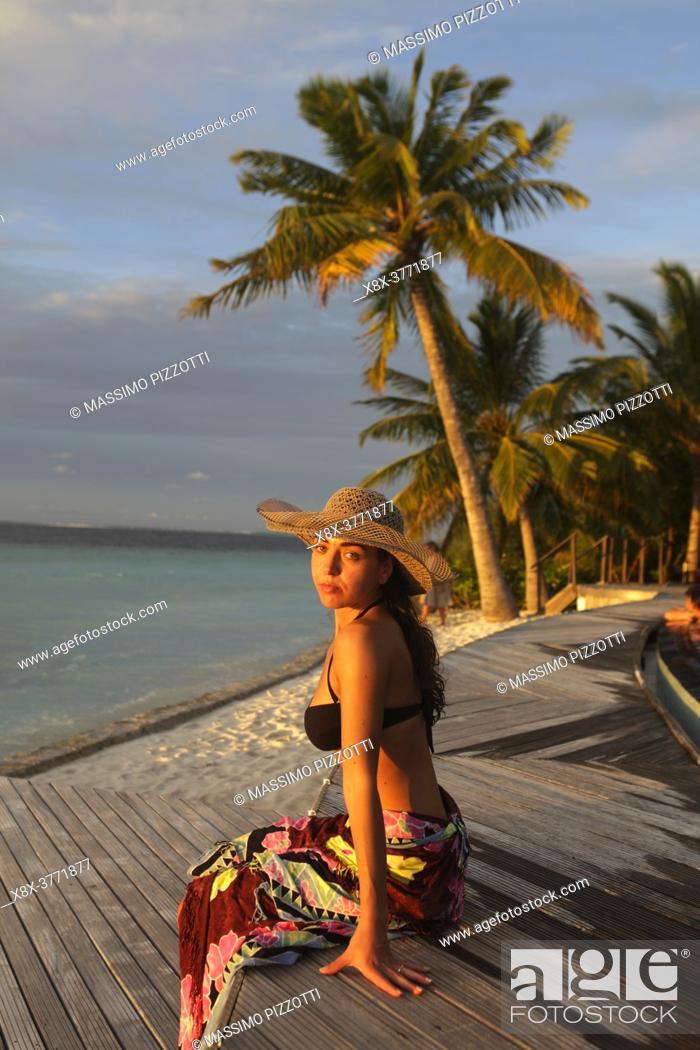 Stock Photo: Girl seated on the pool side, Filitheyo island, Maldives.