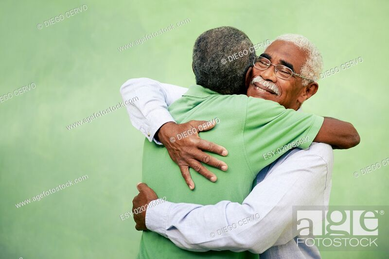 Stock Photo: Old friends, two senior african american men meeting and hugging.