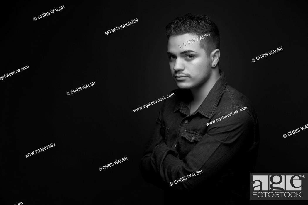 Imagen: Black and white portrait teenage boy serious.
