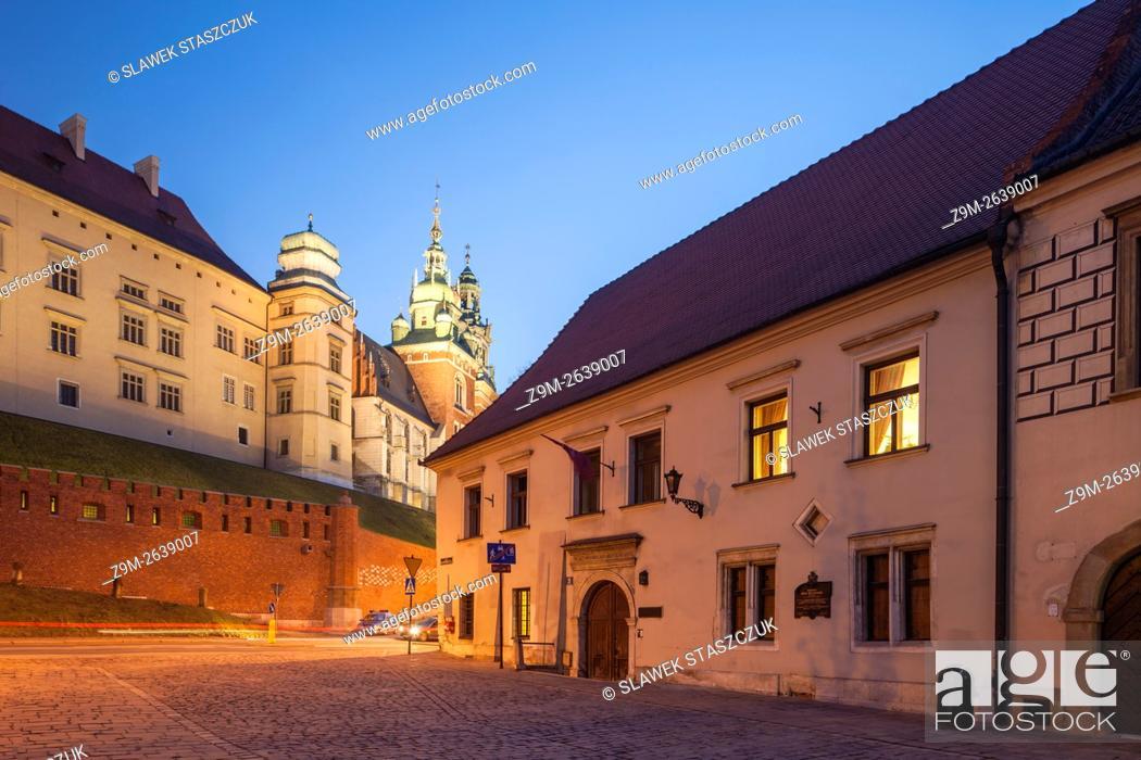 Stock Photo: Night falls on Grodzka street in Krakow old town, Malopolska, Poland. UNESCO world heritage site.