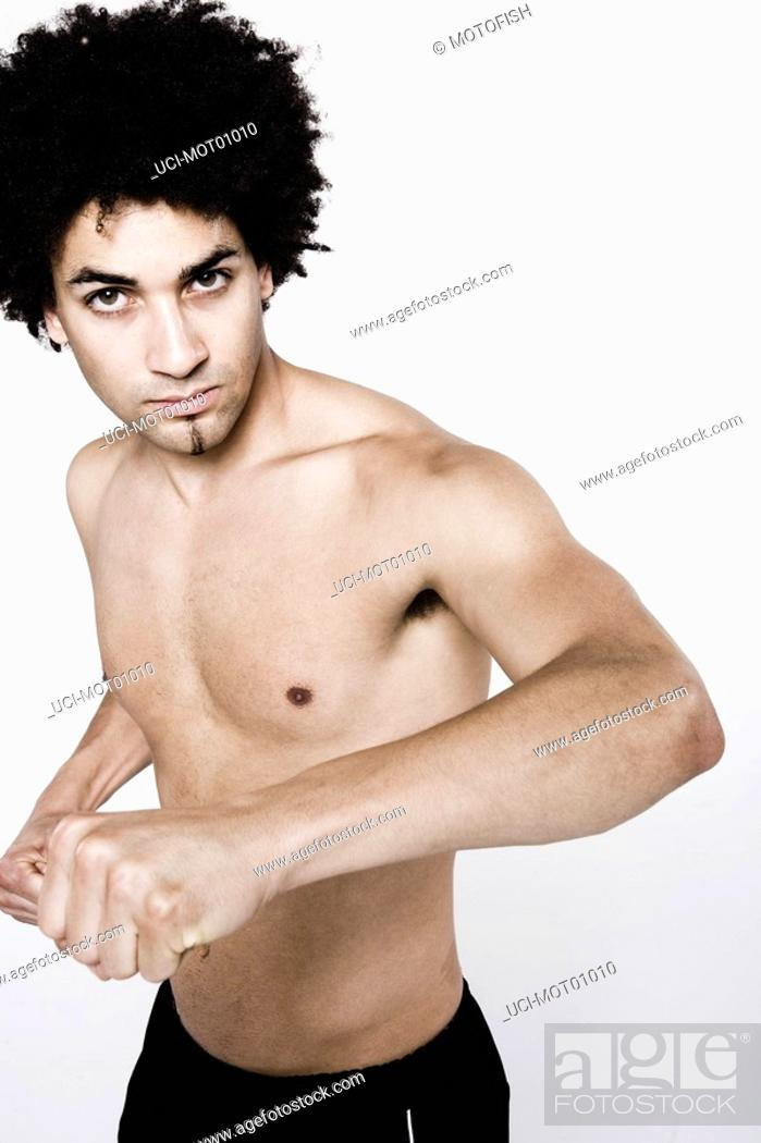 Stock Photo: Bare-chested man holding arm out.