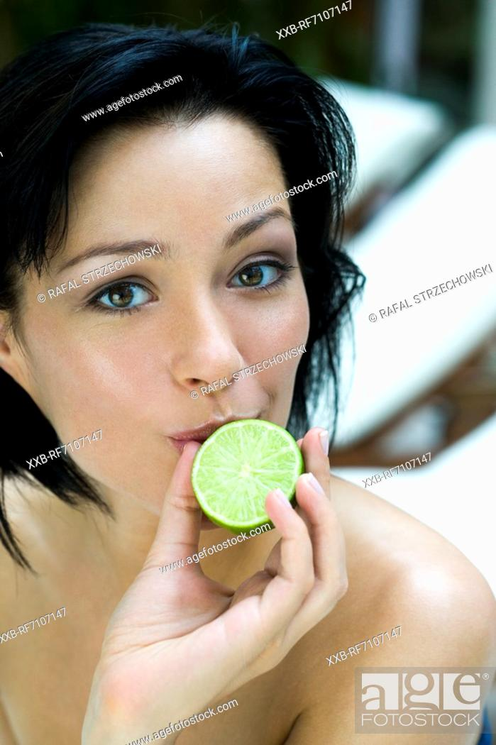 Stock Photo: Woman with lime.