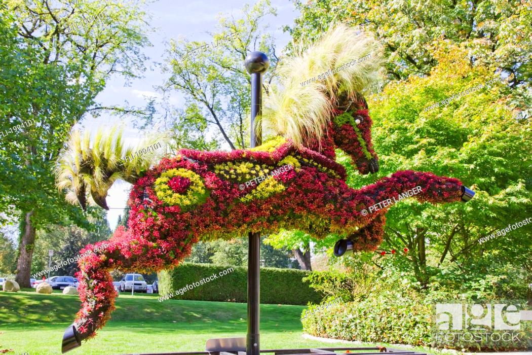 Stock Photo: Ornamental Hedge In The Shape Of A Carousel Horse In Front Of The Shadbolt Centre For The Arts, Burnaby, British Columbia, Canada.