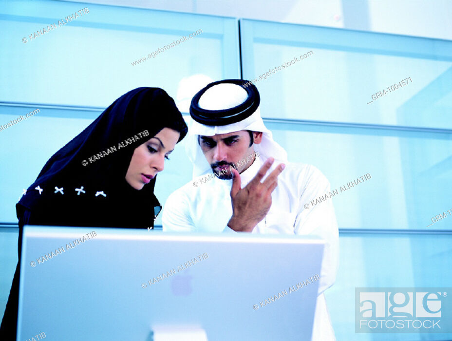 Stock Photo: Arab businesspeople working on computer.