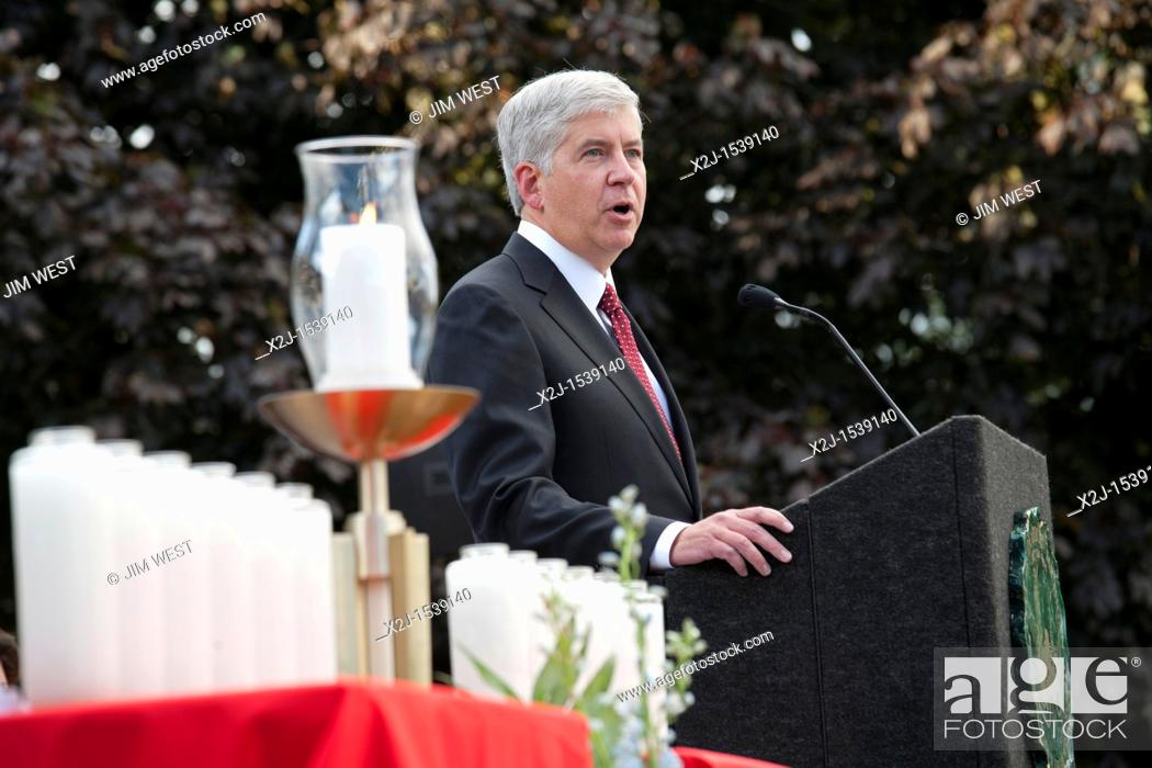Stock Photo: Dearborn, Michigan - Michigan Governor Rick Snyder speaks at an interfaith 'Remembrance and Unity Vigil' at The Henry Ford museum commemorating the tenth.