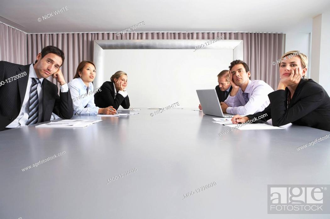 Stock Photo: Bored Businesspeople Sitting in Conference Room.