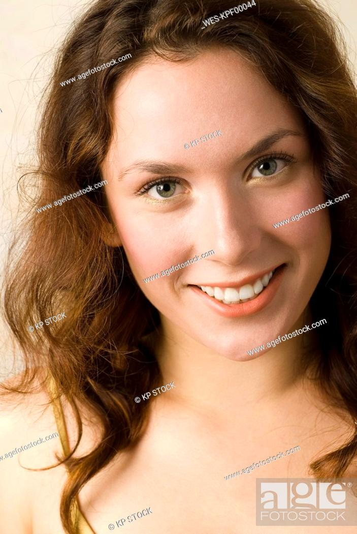 Stock Photo: Young woman, Smiling, portrait, close up.