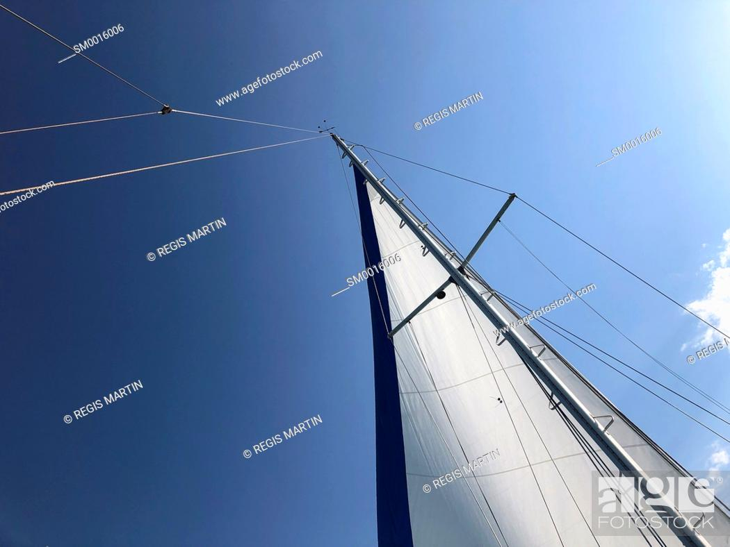Stock Photo: Sail of a sailboat against the sky.