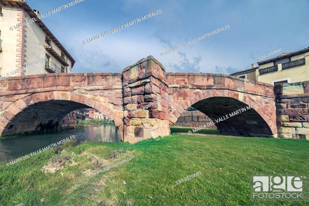 Stock Photo: Historical medieval bridge across river Gallo in Molina de Aragon. Guadalajara. Spain. Europe.