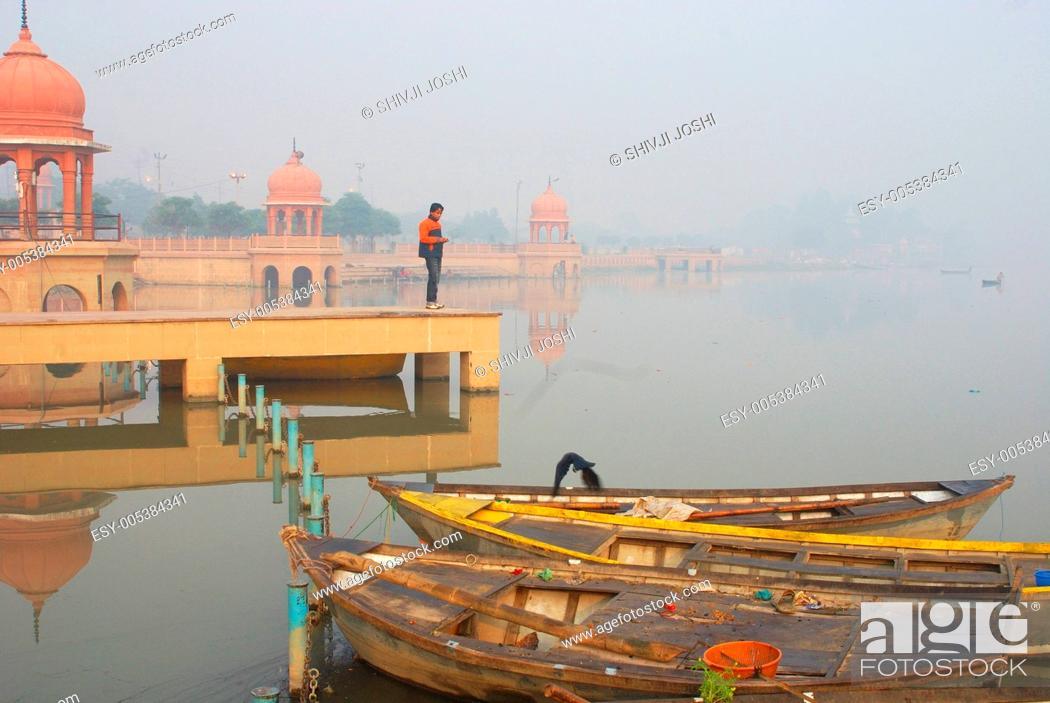 Stock Photo: Small boats at Kudia Ghat of Gomati river ; Lucknow ; Uttar Pradesh ; India.