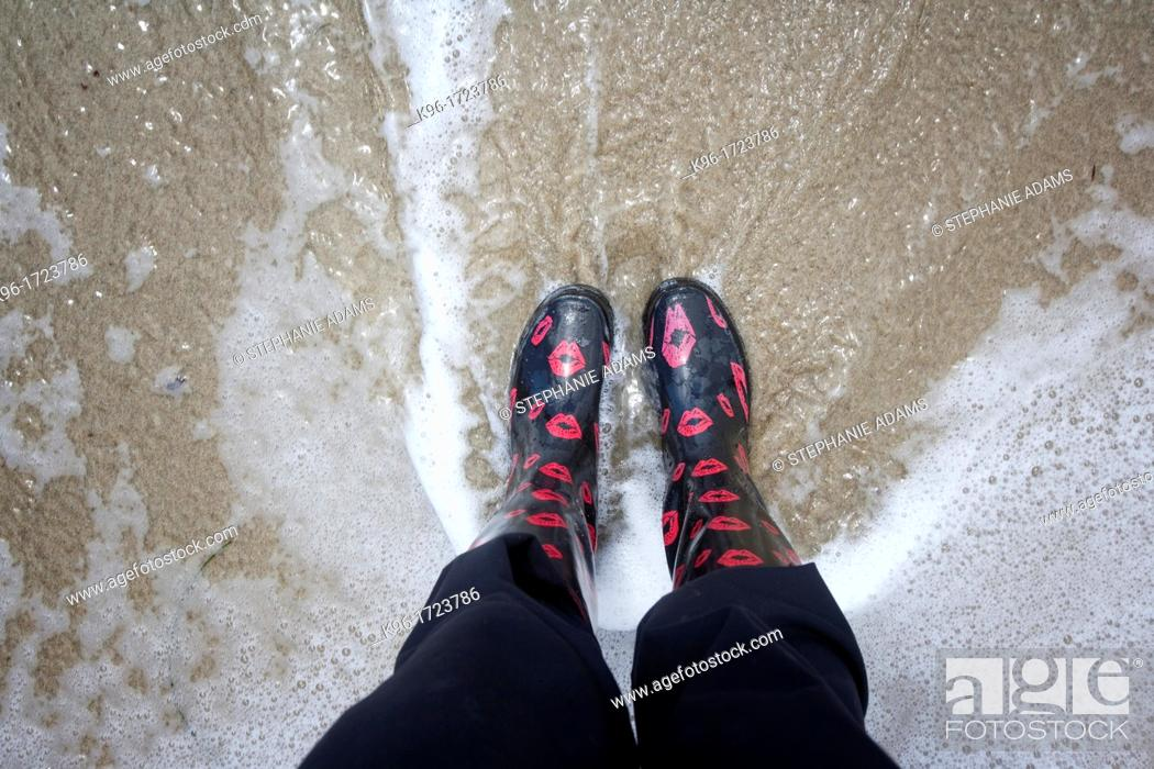 Stock Photo: Rain boots in the water.