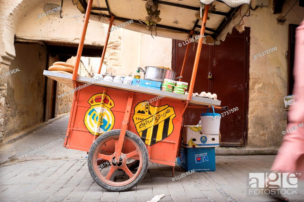 Stock Photo: Street food stand with emblems of Real Madrid and MAS Fez. Fez, Morocco.