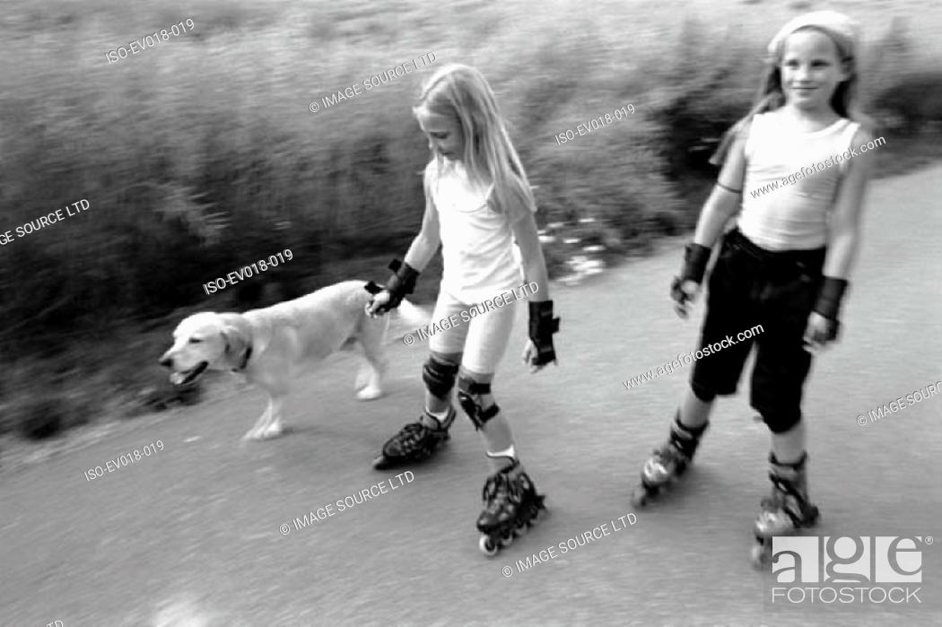 Stock Photo: Girls on roller-blades.