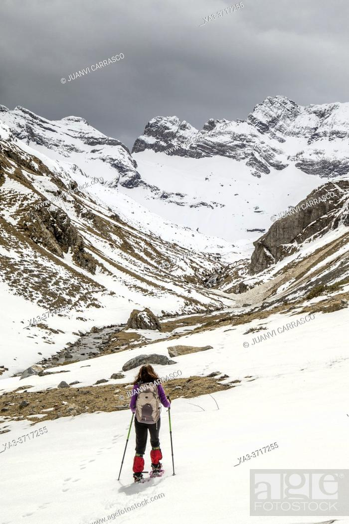 Stock Photo: Woman hiking in Estaube valley, Pyrenees national park, France.