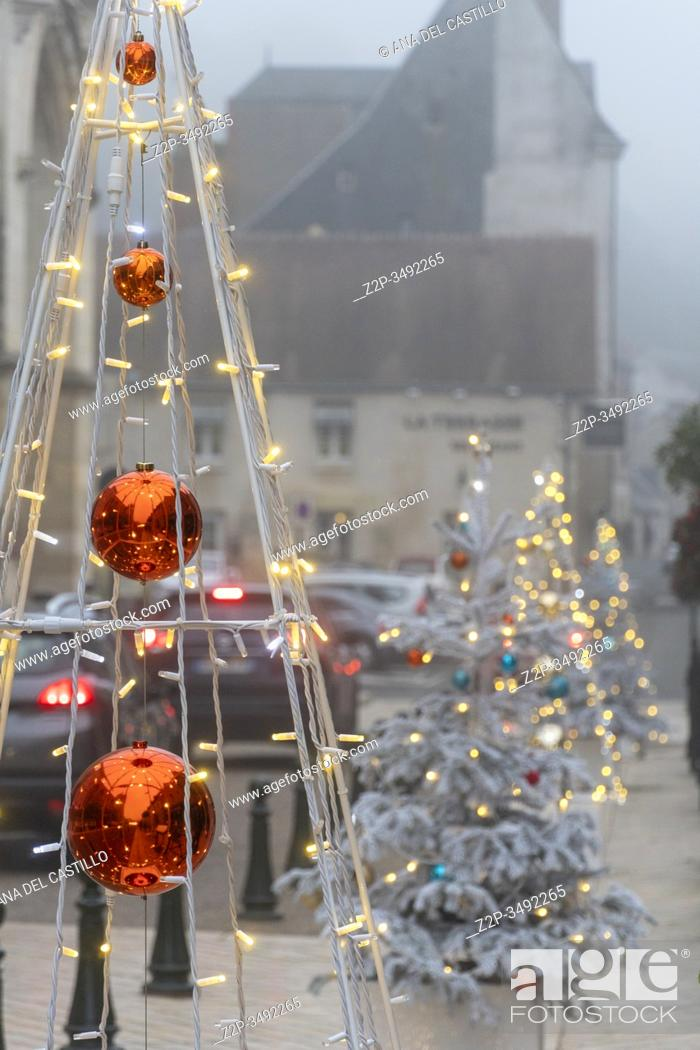 Stock Photo: AMBOISE LOIRE VALLEY FRANCE ON DECEMBER 31, 2019: Christmas trees at the Medieval city in a foggy morning.