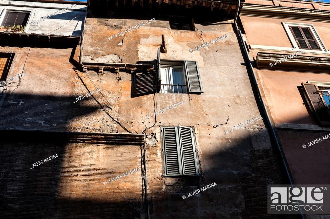 Stock Photo: Detail of a building in Via del Portico di Ottavia, Rome, Italy.
