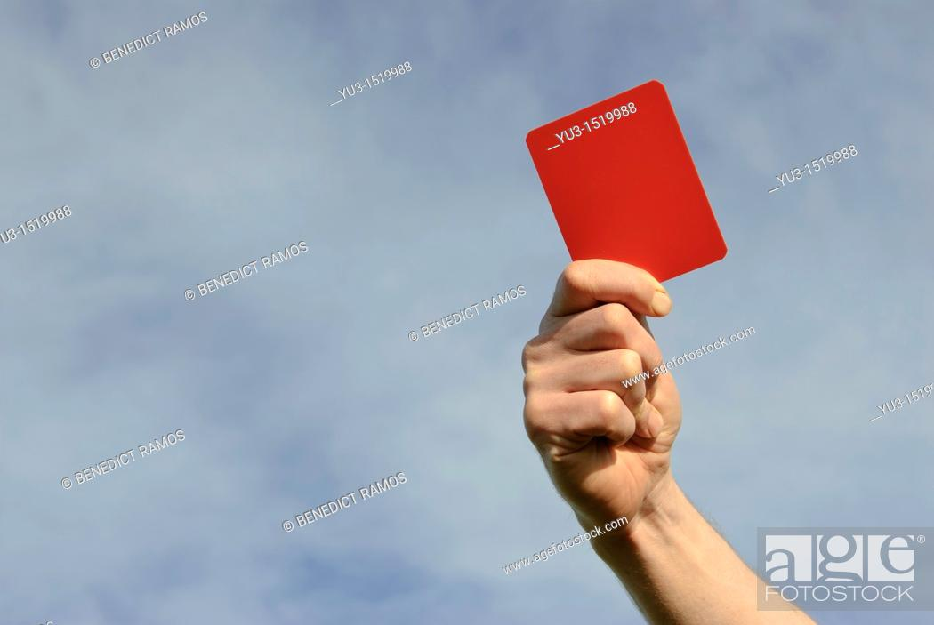 Stock Photo: Hand of referee waving red card.