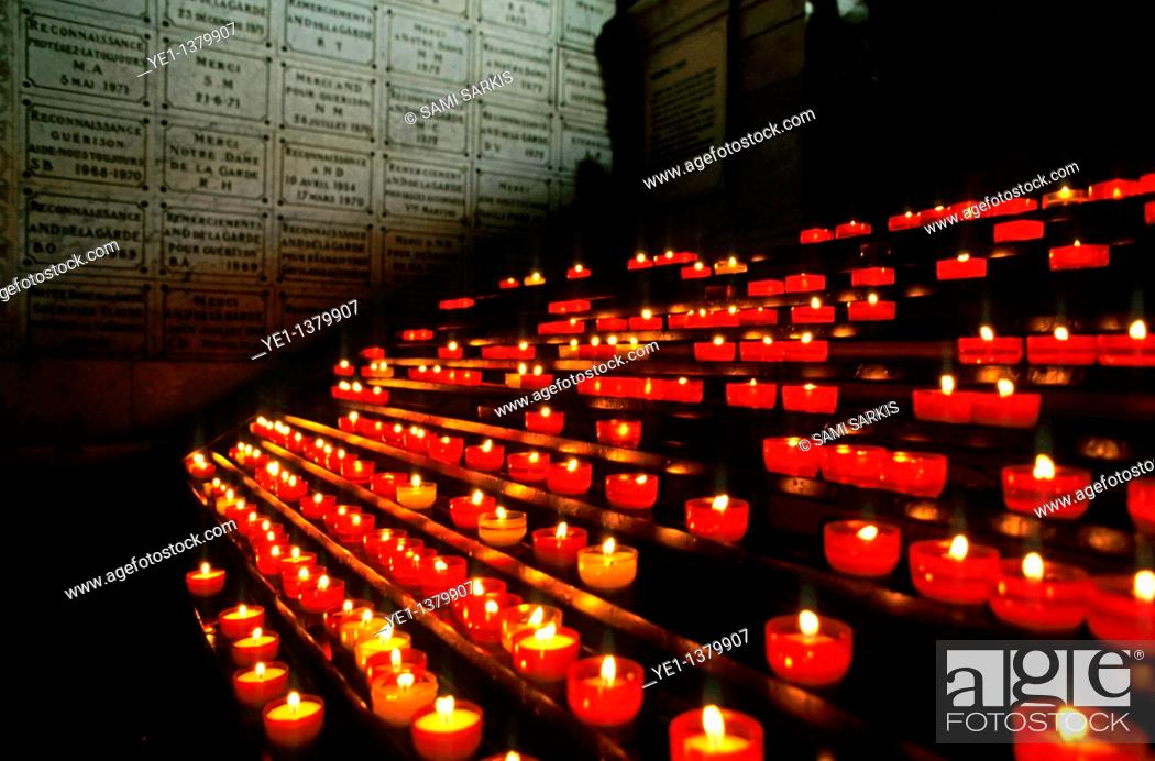 Stock Photo: Burning candles inside the crypt at Notre-Dame de la Garde, Marseille, France.