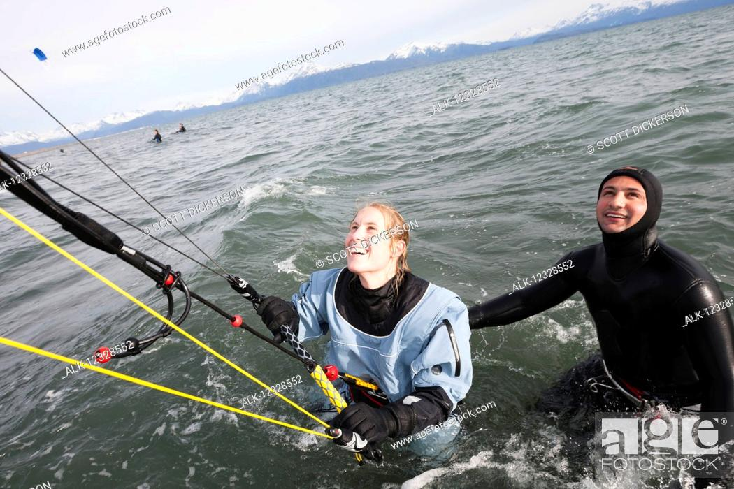 Imagen: Woman taking instruction in a kitesurfing class, Kachemak Bay, South-central Alaska; Alaska, United States of America.