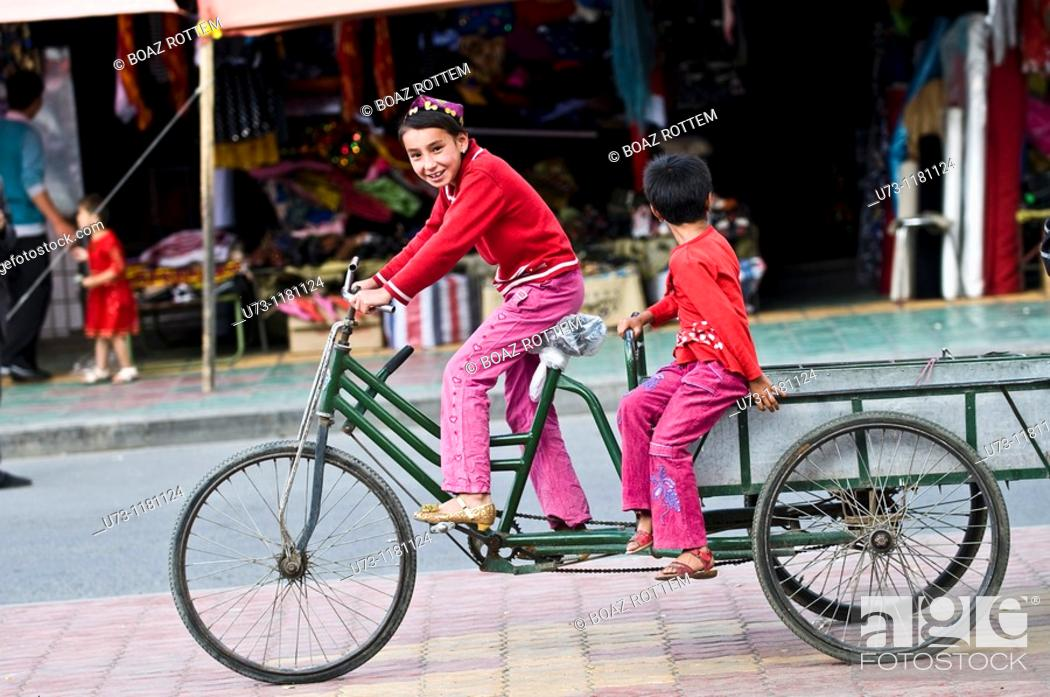 Stock Photo: girls on their cycle.