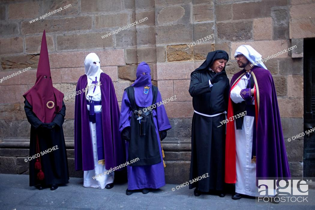 Stock Photo: Penitents from different brotherhoods during an Easter Holy Week procession in Astorga, Castilla y Leon, Spain.
