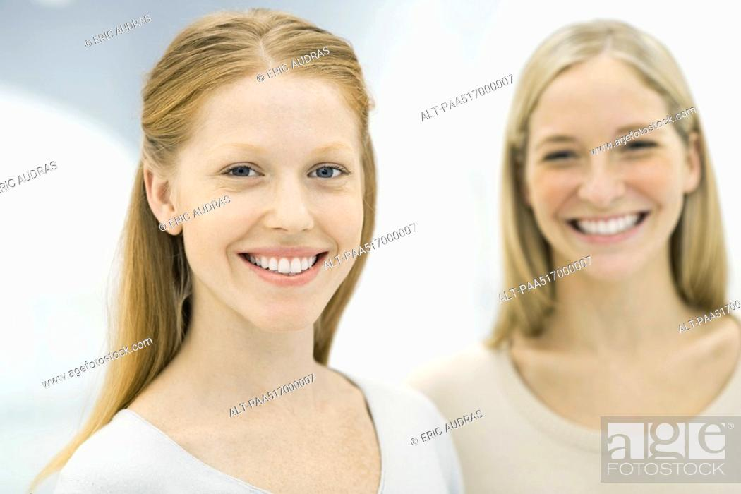 Stock Photo: Two women smiling at camera, portrait.
