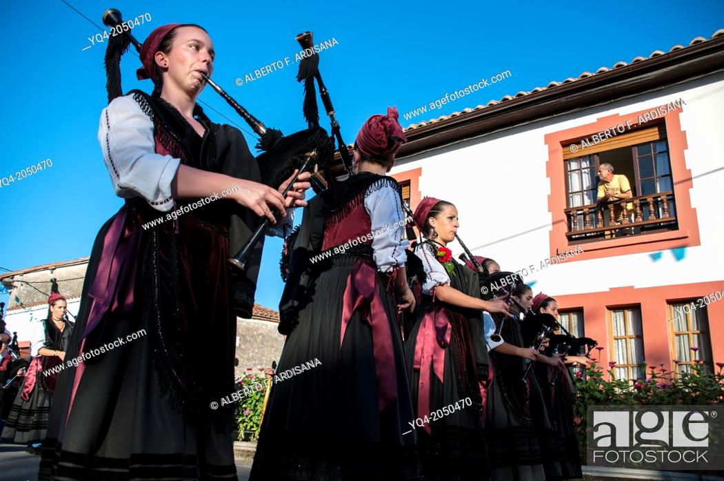 Stock Photo: Women playing bagpipes and marching during the holiday Llanes. Asturias Spain.