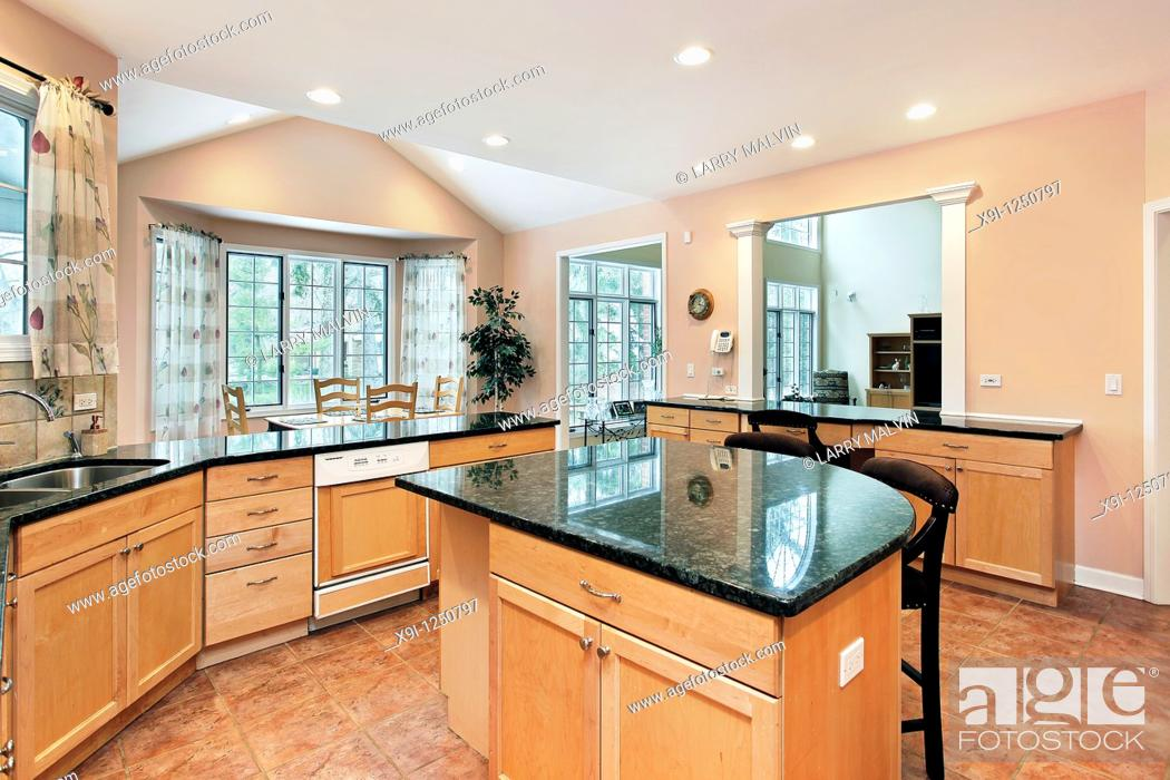 Stock Photo: Kitchen in luxury home with marble top island.