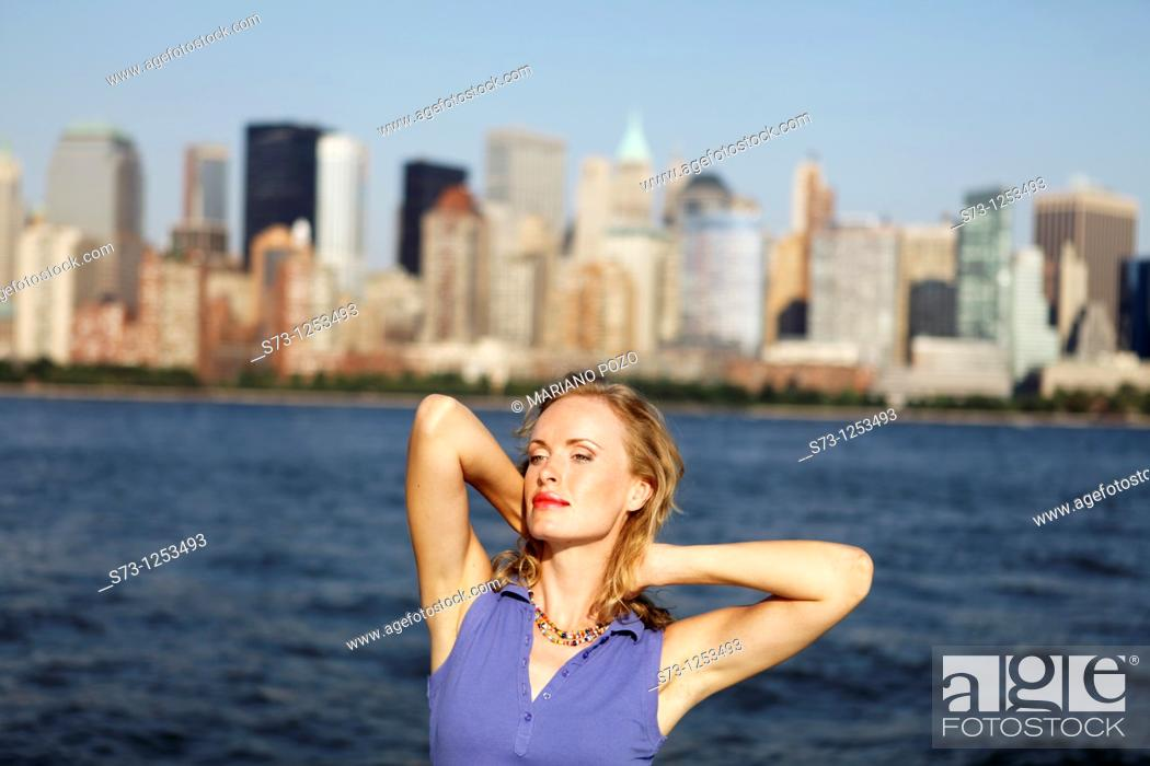 Stock Photo: Young woman on a ferryboat, Manhattan, New York, USA.