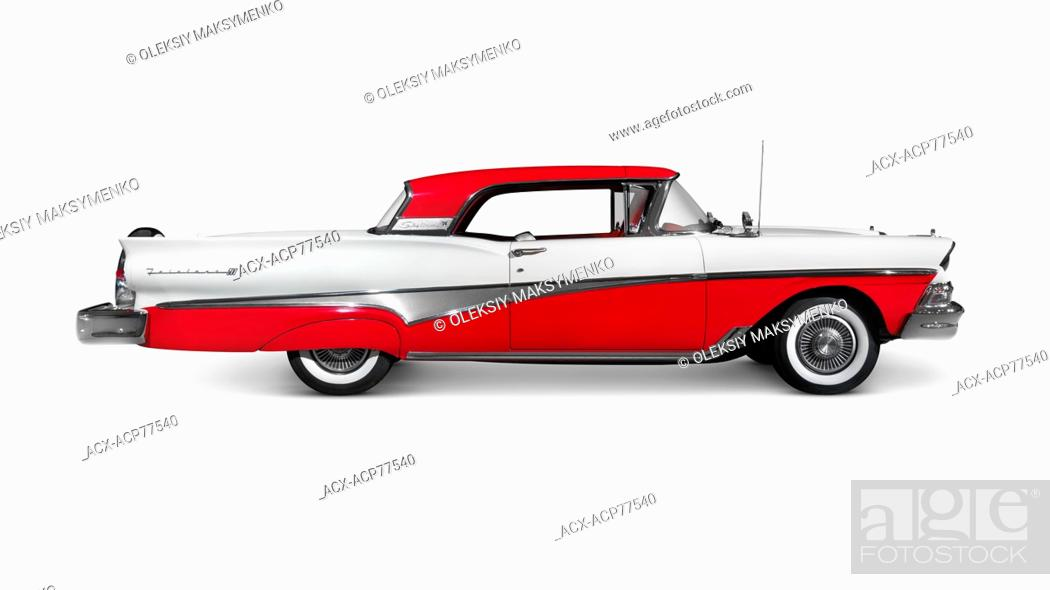 Stock Photo: Red and white 1958 Ford Fairlane 500 Skyliner classic retro car side view isolated on white background with clipping path.