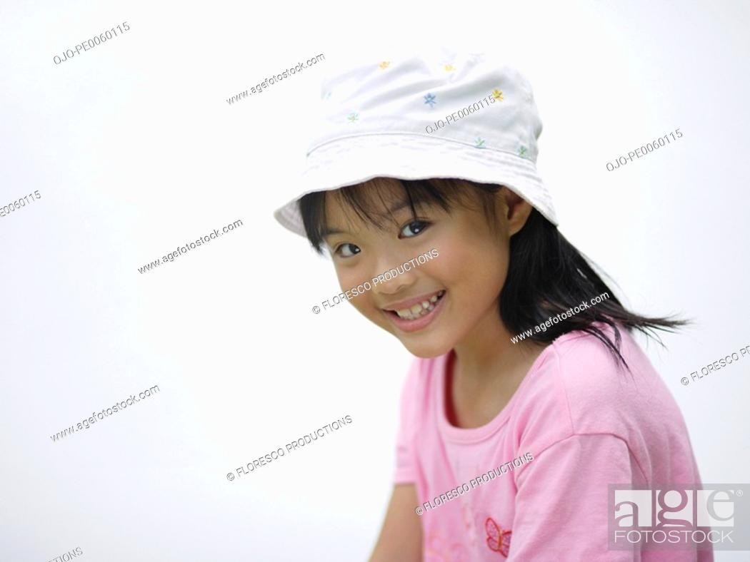 Stock Photo: Young girl indoors smiling.