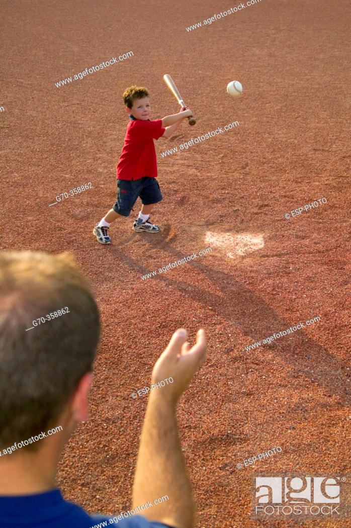 Stock Photo: Father and son playing baseball.