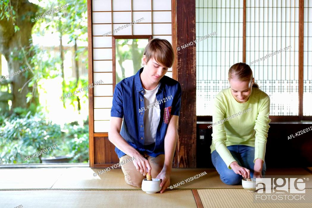 Stock Photo: Caucasian couple enjoying tea ceremony at traditional Japanese house.