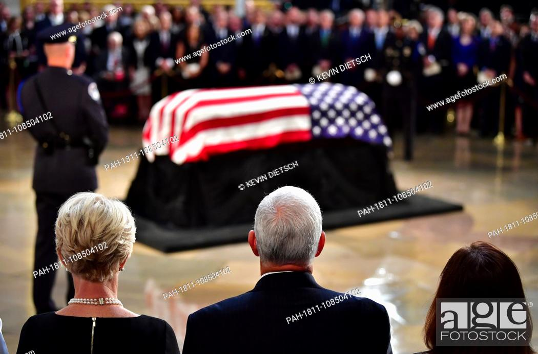 Stock Photo: Vice President of the United Staes Mike Pence and wife Karen Pence view the casket of former Senator John McCain in the Capitol Rotunda where he will lie in.