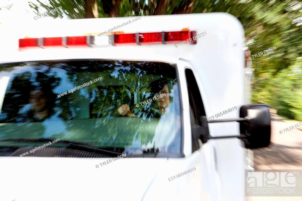 Stock Photo: Paramedics in Speeding Ambulance.