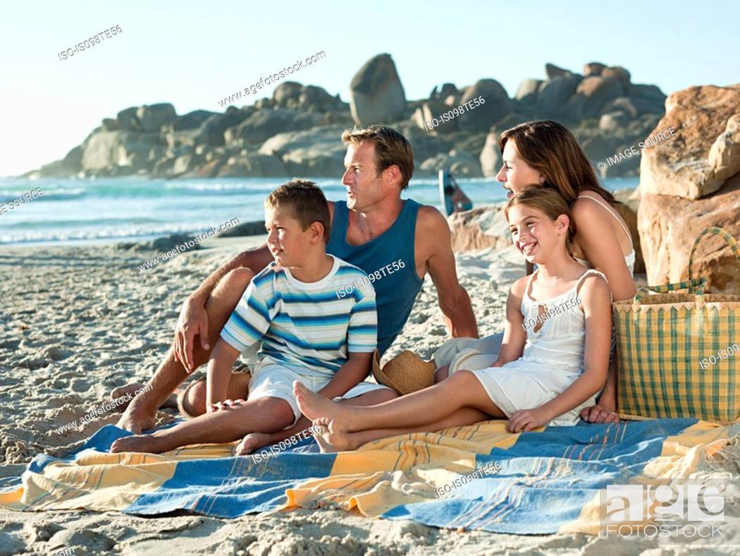 Stock Photo: Family sitting on the beach.