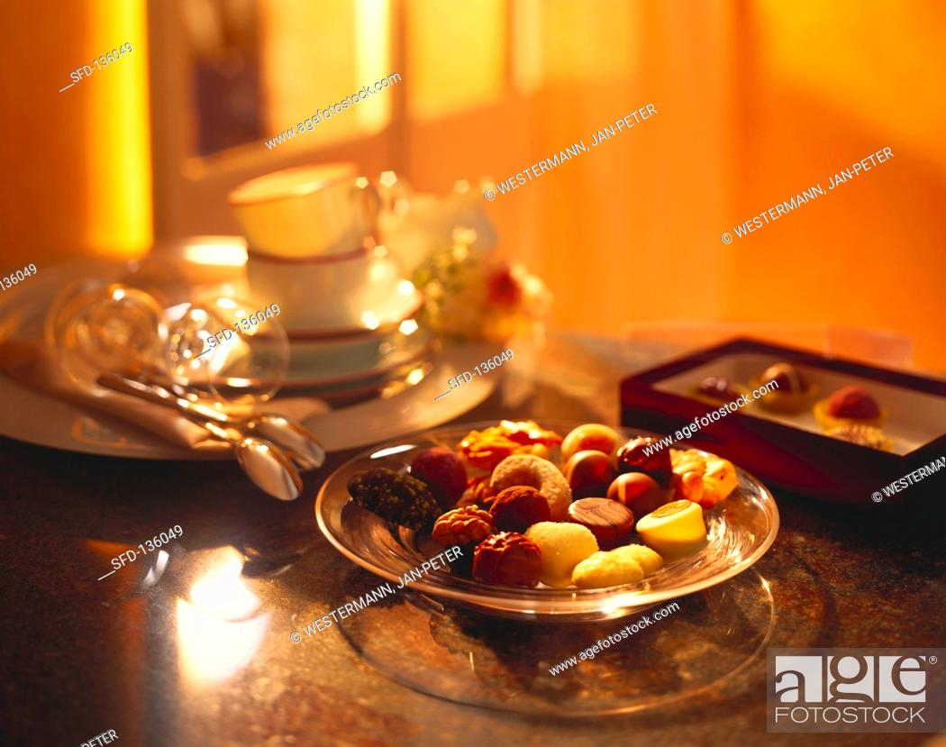 Stock Photo: Assorted chocolates on glass plate on table.