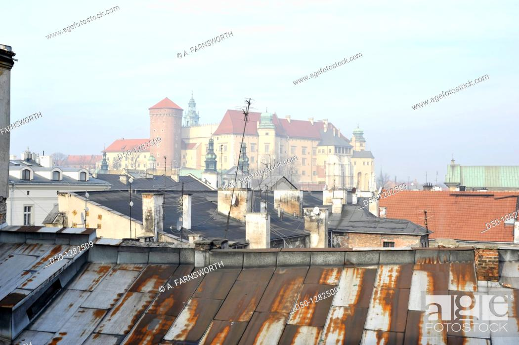 Stock Photo: The Royal Palace over the rooftops, Krakow, Poland.