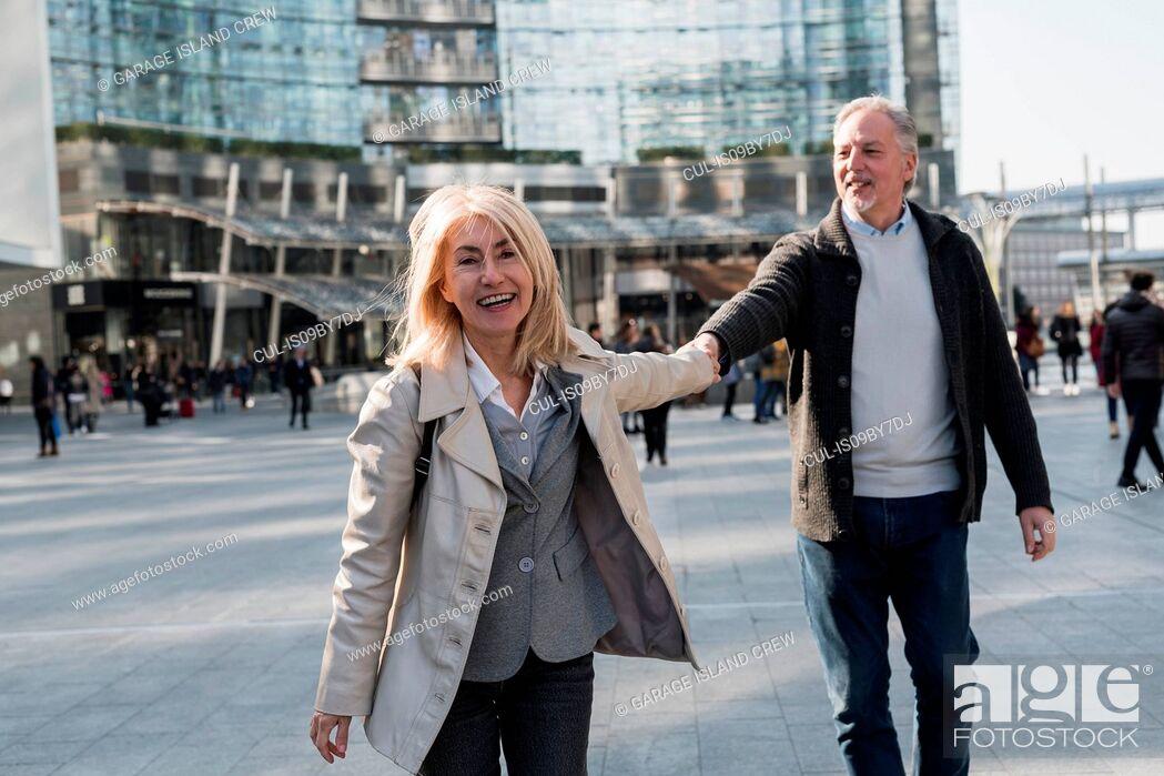 Stock Photo: Senior couple exploring city, Milan, Lombardia, Italy.