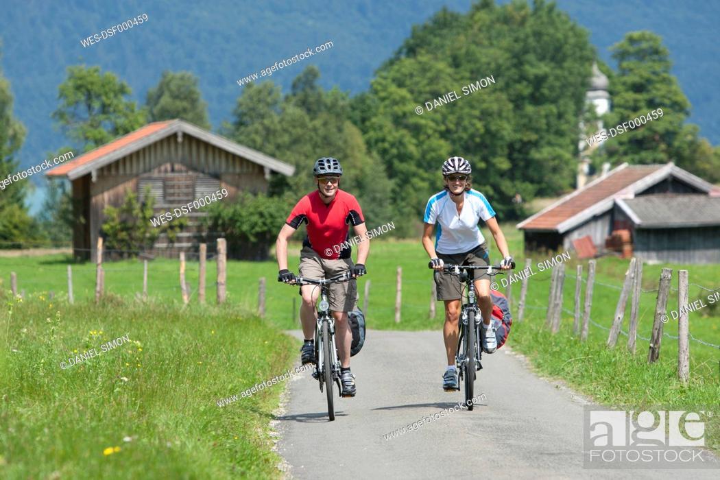 Stock Photo: Germany, Bavaria, Zwergern, Man and woman riding bicycle.