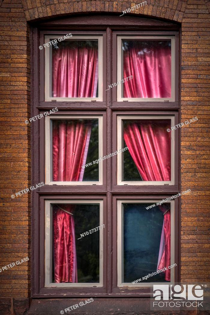 Stock Photo: Red curtains in a window.