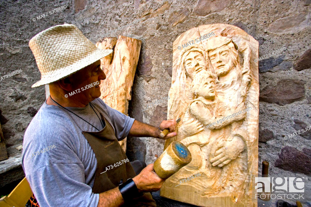 Stock Photo: 'Dal Medioevo al Terzo Millennio' Exhibition. The wood-carver Gianmario Monella at work. Sellero. Lombardia-Valcamonica. Italy.