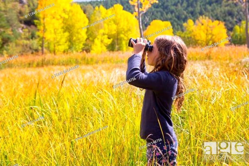 Stock Photo: Explorer binocuar kid girl in yellow autumn nature.