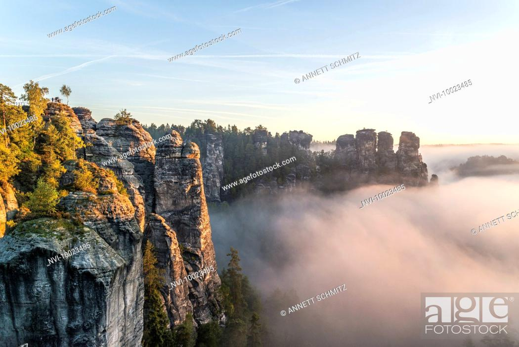 Stock Photo: Bastei and Kleine Gans rock at sunrise, Elbe Sandstone Mountains, Saxony, Germany.